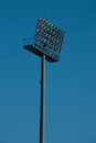 Floodlight stadium lights riflettore against the blue sky Royalty Free Stock Images