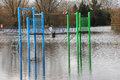 Floods engulf a children s play area park is engulfed as river breaks its banks fordingbridge hampshire england uk Royalty Free Stock Images