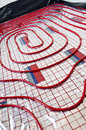 Floor heating installation red plastic pipes of with reflective foil house building and renovation stage Stock Images
