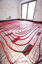 Floor heating installation red plastic pipes of with reflective foil house building and renovation stage Stock Photo