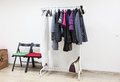 Floor rack with outerwear in interior hallway room, nobody Royalty Free Stock Photo