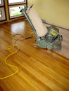 Floor sander a hardwood being sanded by a vintage Royalty Free Stock Image
