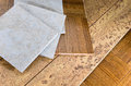Flooring sections of wood cork and tile ceramic parquet wooden samples for home interior remodel Stock Photo