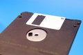 Floppy disk,black floppy blue background Royalty Free Stock Photo