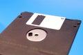 Floppy disk,black floppy blue background Royalty Free Stock Photo