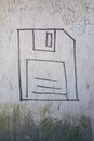 Floppy disk graffiti drawing of a on a dirty wooden wall Royalty Free Stock Photo