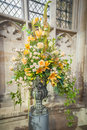 Floral arrangement huge wedding bouquet on display in a church Royalty Free Stock Photos