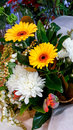 Floral arrangement with yellow daisies