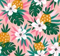 Floral background with tropical hawaiian flowers, leaves and pineapples. Vector seamless pattern for fabric design.