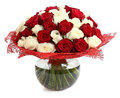 Floral compositions of red and white roses. A large bouquet of mixed colored roses. Design a bouquet of different color roses