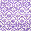 Floral design on fabric swirls in purple color Royalty Free Stock Photography