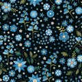Floral fancywork. Embroidered seamless pattern. Embroidery blue flowers on black background. Print for fabric and textile
