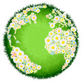 Floral flower globe concept a world earth with continents made up of flowers and seas as grass for environmental issues or peace Stock Photo