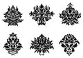 Floral and foliate design elements black silhouetted damask Stock Image