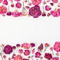 Floral pattern made of pink bush roses, white blank, green leaves on gray background. Flat lay, top view. Valentine`s.