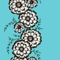 Floral ornament in the form of camomiles on a blue backgr Royalty Free Stock Photo