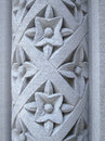 Floral pattern carved into a stone pillar Royalty Free Stock Photo