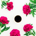 Floral pattern of peony, leaves and hot black coffee mug on white background. Flat lay, top view. Beauty concept Royalty Free Stock Photo