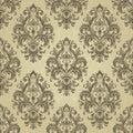 Floral pattern. Wallpaper baroque, damask. Gold color