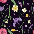 Floral seamless pattern with beautiful blooming spring flowers hand drawn in antique style on black background