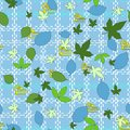 Floral seamless pattern of blue, dark and light green leaves. Cornflower blue background with a light cell from dotted lines