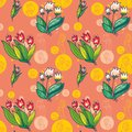 Floral seamless pattern of bright tulips on a pink Royalty Free Stock Photo