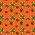 Floral vector pattern: multicolored flowers with many petals on an orange background. Main colors: yellow, orange, blue, pink. Royalty Free Stock Photo