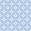 Floral white lacy seamless pattern on blue background Royalty Free Stock Images