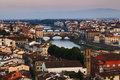 Florence city bridges rise italy tuscany panoramic view over downtown arno river and ponte vecchio red roofs of old town at Royalty Free Stock Images