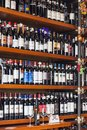 stock image of  Bottles of wine on shelves in a store in Italy