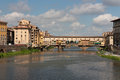 Florence ponte vecchio by a cloudy day view of famous old bridge from Royalty Free Stock Photos