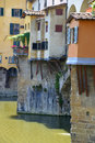 Florence ponte vecchio is a famous medieval bridge over the river arno in italy Stock Photos