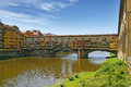 Florence ponte vecchio is a famous medieval bridge over the river arno in italy Stock Images