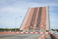 Florida drawbridge raises on road over river to allow boats to pass Stock Images