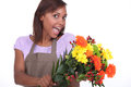 Florist excited about a customer s order Stock Photography