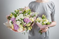 Florist girl with rich bunch flowers. Fresh spring bouquet. Summer Background. Young woman  flower  for birthday or Royalty Free Stock Photo