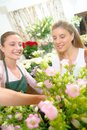 Florist making a sale Royalty Free Stock Photo