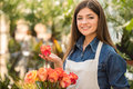 Florist portrait of young female holding bouquet with roses Royalty Free Stock Photos