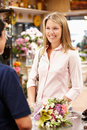 Florist serving customer Royalty Free Stock Photography