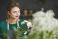 Florist smelling flowers Royalty Free Stock Photo