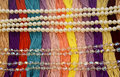 Floss with beautiful multi-colored pearls and beads Royalty Free Stock Photo