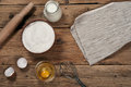 Flour in a bowl with ingredients for preparing baked products Royalty Free Stock Photo