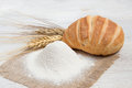 Flour bread and wheat background Royalty Free Stock Photos