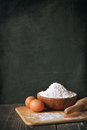 Flour and eggs on a blackboard background copy space Royalty Free Stock Photo
