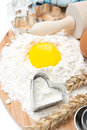 Flour eggs rolling pin and baking forms top view vertical Royalty Free Stock Image