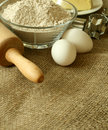 Flour, oil, eggs and rolling pin Royalty Free Stock Photos