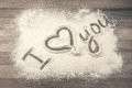 Flour on the table with text i love you Stock Image
