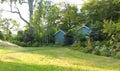 Flourishing farm backyard with sheds and garden house Royalty Free Stock Photo