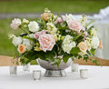 Flower arrangement in silver bowl with pink and white roses Stock Images