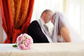 Flower Arrangement and a wedding couple Stock Photography